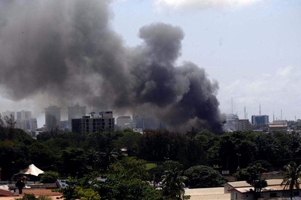 Smoke rises from the Nigeria Correctional service facility in Lagos, Nigeria on Thursday (AP)