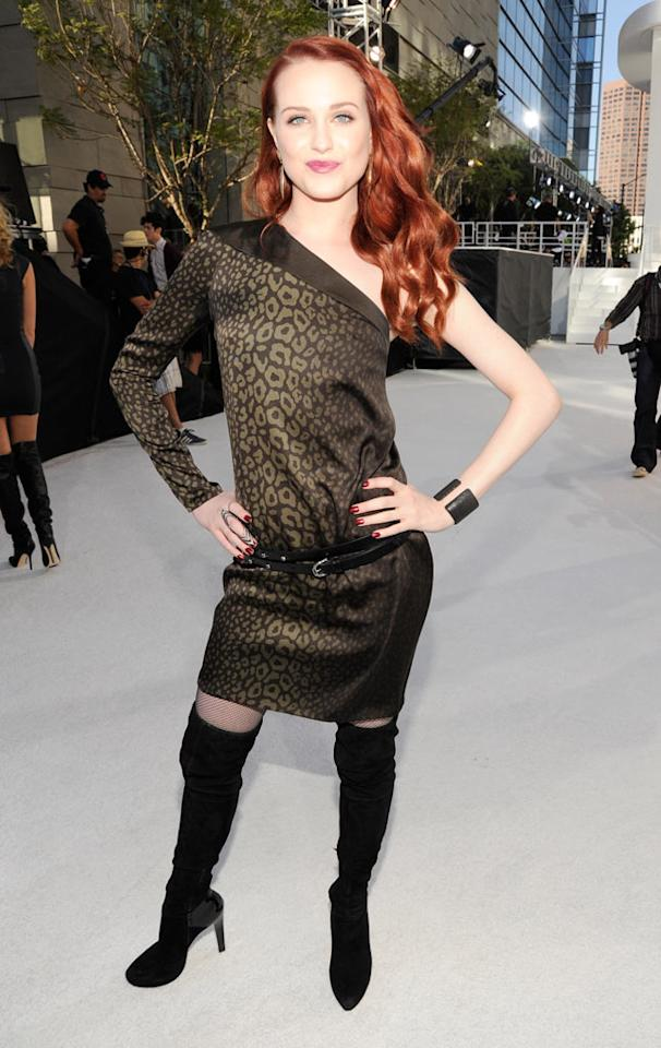 """Marilyn Manson's former flame Evan Rachel Wood pursed her lips and struck a pose in an ill-fitting, one-shoulder dress and thigh-high boots. Kevin Mazur/<a href=""""http://www.wireimage.com"""" target=""""new"""">WireImage.com</a> - September 12, 2010"""
