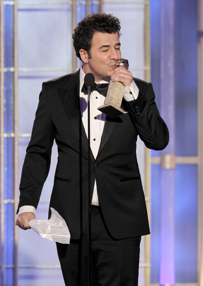 "BEVERLY HILLS, CA - JANUARY 15: In this handout photo provided by NBC, composer Ludovic Bource accepts the award for Best Original Score - Motion Picture ""The Artist"" onstage during the 69th Annual Golden Globe Awards at the Beverly Hilton International Ballroom on January 15, 2012 in Beverly Hills, California. (Photo by Paul Drinkwater/NBC via Getty Images)"