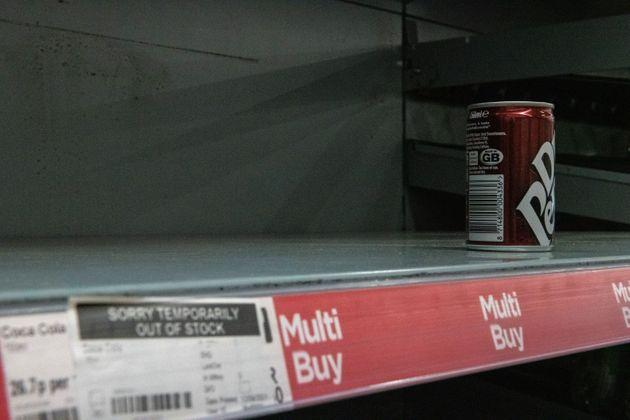 One remaining can of soft drink on a near-empty shelf at Asda (Photo: Chris J Ratcliffe via Getty Images)