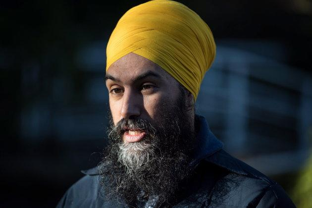 NDP Leader Jagmeet Singh is interviewed while door knocking for his byelection campaign in Burnaby, B.C., on Jan. 12, 2019.
