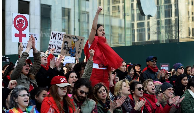 Women participate in a protest on 5th Avenue near Trump Tower in New York March 8, 2017 during a #DayWithoutAWoman protest in New York (AFP Photo/TIMOTHY A. CLARY)