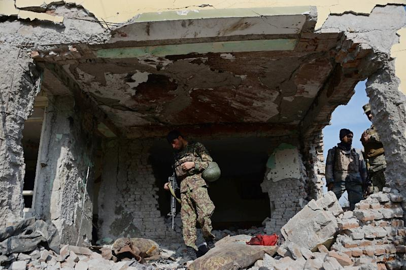 Afghan security personnel inspect a building used by insurgents to launch an attack on the Pakistan consulate in Jalalabad (AFP Photo/Noorullah Shirzada)