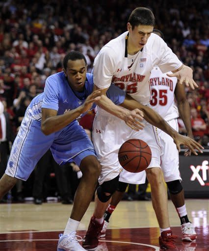 North Carolina forward John Henson, left, fights for the ball against Maryland center Alex Len, right, during the second half of an NCAA college basketball game, Saturday, Feb. 4, 2012, in College Park, Md. North Carolina won 83-74. (AP Photo/Nick Wass)