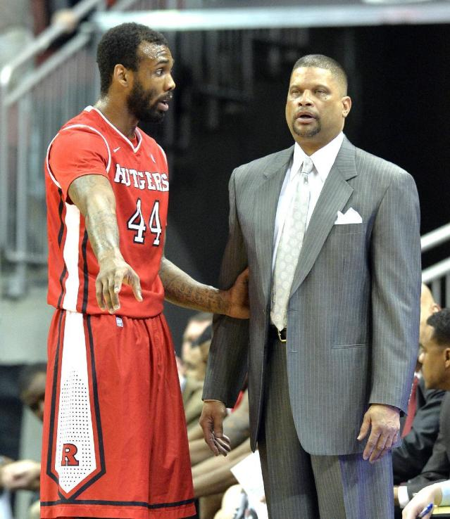 Rutgers head coach Eddie Jordan, right, talks with J.J. Moore during the second half of an NCAA college basketball game against Louisville, Sunday, Feb. 16, 2014, in Louisville, Ky. Louisville won 102-54. (AP Photo/Timothy D. Easley)