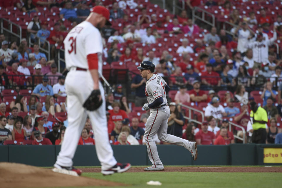 St. Louis Cardinals starting pitcher Jon Lester walks off the mound after giving up a home run to Atlanta Braves' Freddie Freeman, rear, during the second inning of a baseball game Tuesday, Aug. 3, 2021, in St. Louis. (AP Photo/Joe Puetz)