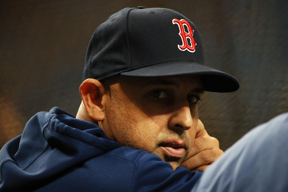 ST PETERSBURG, FLORIDA - OCTOBER 07: Manager Alex Cora #13 of the Boston Red Sox looks on during batting practice prior to Game 1 of the American League Division Series against the Tampa Bay Rays at Tropicana Field on October 07, 2021 in St Petersburg, Florida. (Photo by Mike Ehrmann/Getty Images)