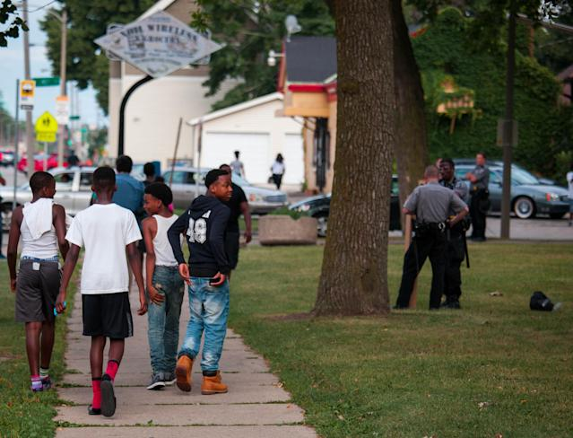 MILWAUKEE, WI - AUGUST 15: Members of the Milwaukee County Sheriff Dept. secure Sherman Park after a 6pm curfew was enacted after a second night of clashes between protestors and police August 15, 2016 in Milwaukee, Wisconsin. Hundreds of angry people have confronted police after an officer shot and killed a fleeing armed man. (Photo by Darren Hauck/Getty Images)