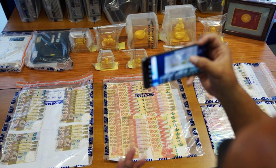 Some of the evidence seized during the operation is displayed during a press conference at police headquarters in Wan Chai. Photo: Sam Tsang