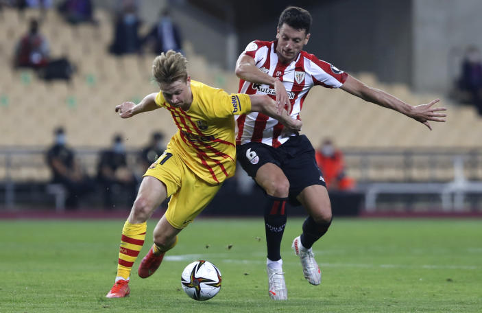 Barcelona's Frenkie de Jong fights for the ball against Athletic Bilbao's Mikel Vesga during the Spanish Copa del Rey final 2021 between Athletic Bilbao and Barcelona at La Cartuja stadium in Seville, Spain, Saturday April 17, 2021. (AP Photo/Angel Fernandez)
