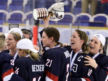Team USA players including Hilary Knight, Meghan Duggan and Brianna Decker celebrate with the World Cup trophy after the 2015 IIHF Ice Hockey Women's World Championship gold medal match in Malmo