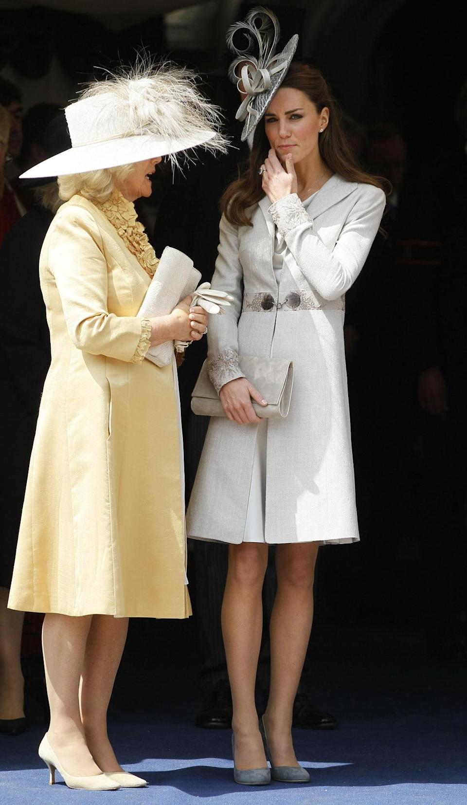 <p>For the Order of the Garter service, Kate chose a dove grey ensemble by Katherine Hooker with an ornate hat by milliner Rachel Trevor-Morgan. She teamed the look with suede pumps by Rupert Sanderson. </p><p><i>[Photo: PA]</i></p>