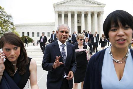 Aereo CEO and founder Chet Kanojia (C) departs the U.S. Supreme Court in Washington April 22, 2014. REUTERS/Jonathan Ernst