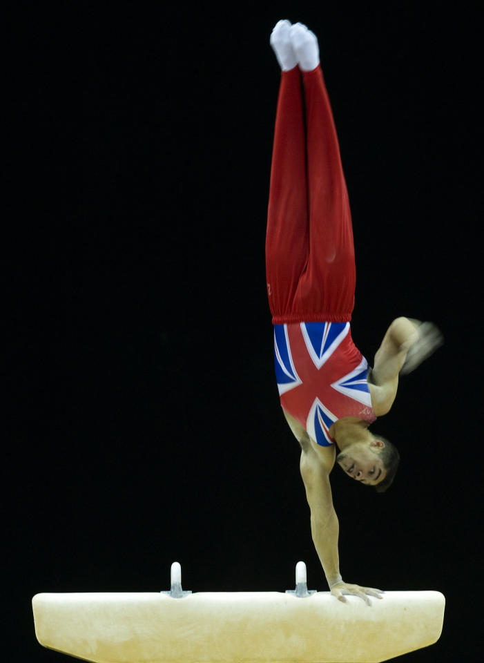 Louis Smith of Great Britain competes during the Men's pommel horse final during the Artistic International Gymnastics London 2012 Olympic qualifier, a part of the London Prepares series of test events, at the North Greenwich Arena in London on January 12, 2012. AFP PHOTO / ADRIAN DENNIS (Photo credit should read ADRIAN DENNIS/AFP/Getty Images)