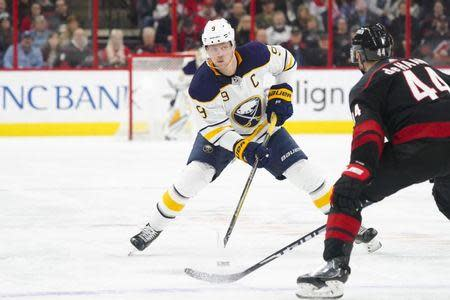 Jan 11, 2019; Raleigh, NC, USA; Buffalo Sabres center Jack Eichel (9) skates with the puck against the Carolina Hurricanes at PNC Arena. The Carolina Hurricanes defeated the Buffalo Sabres 4-3. Mandatory Credit: James Guillory-USA TODAY Sports
