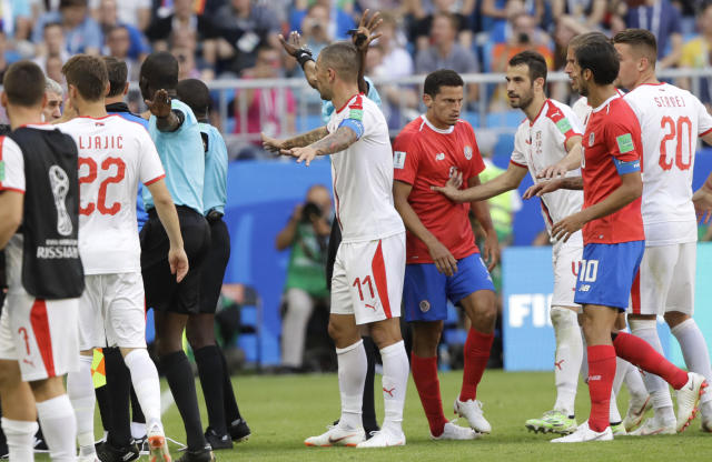 Costa Rica and Serbia players scuffle during the group E match between Costa Rica and Serbia at the 2018 soccer World Cup in the Samara Arena in Samara, Russia, Sunday, June 17, 2018. (AP Photo/Mark Baker)