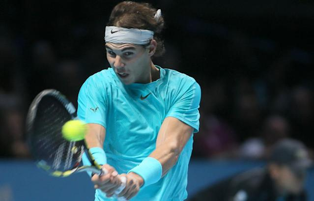 Rafael Nadal of Spain plays a return to Roger Federer of Switzerland during their ATP world Tour Finals tennis semifinal match at the O2 Arena on London, Sunday, Nov. 10, 2013. (AP Photo/Alastair Grant)