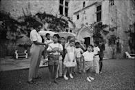 """<p>Josephine takes a photo with her children on the lawn outside the main house. The performer and her children lived on the estate until <a href=""""https://www.departures.com/travel/black-book/josephine-baker%E2%80%99s-french-ch%C3%A2teau"""" rel=""""nofollow noopener"""" target=""""_blank"""" data-ylk=""""slk:they were evicted in 1969"""" class=""""link rapid-noclick-resp"""">they were evicted in 1969</a>, when the château was sold to pay debts Josephine owed.</p>"""