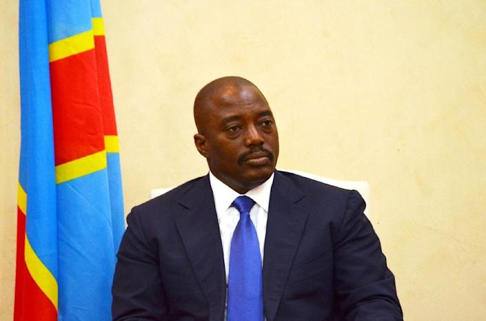 """President Joseph Kabila on Friday launched """"consultations"""" ahead of polls in the Democratic Republic of Congo, where his foes argue he is seeking to cling to power illegitimately (AFP Photo/Tutondele Miankenda)"""