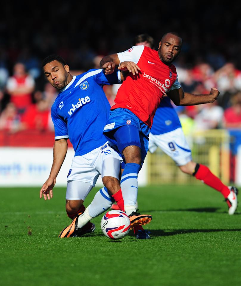 Portsmouth's Andy Barcham (left) and York City's Lanre Oyebanjo in action during the Sky Bet League Two match at Bootham Crescent, York.