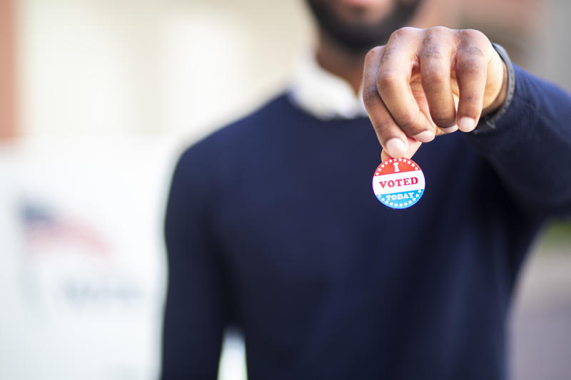 A voting sticker is fine — but campaign badges are best left out of sight. (Photo: Getty Images stock photo)