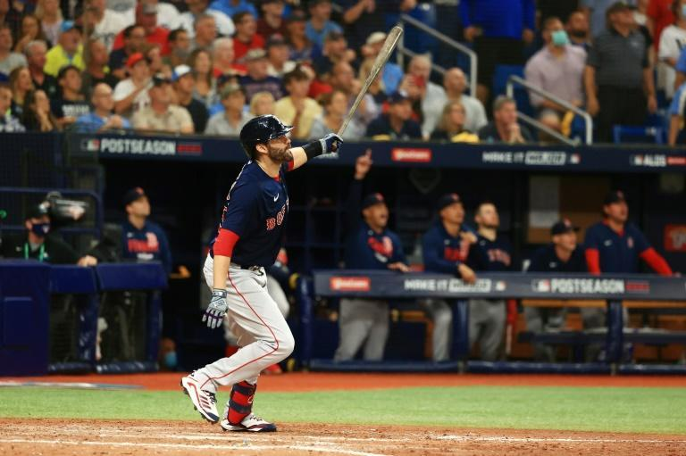 Boston's J.D. Martinez celebrates his three-run home run in the Red Sox's 14-6 victory over the Tampa Bay Rays in the American League division series (AFP/Mike Ehrmann)