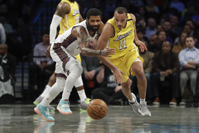 Los Angeles Lakers' Avery Bradley (11) knocks the ball away from Brooklyn Nets' Kyrie Irving (11) during the first half of an NBA basketball game Thursday, Jan. 23, 2020, in New York. (AP Photo/Frank Franklin II)