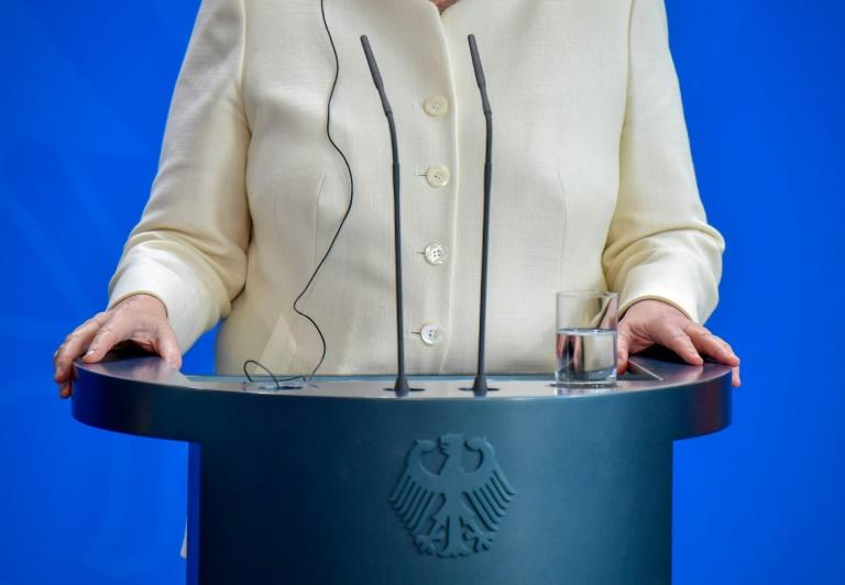 German Chancellor Angela Merkel has suffered three episodes of shaking in public in less than a month (AFP Photo/Tobias SCHWARZ)