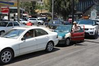 Cars wait in line for fuel at a gas station in Beirut