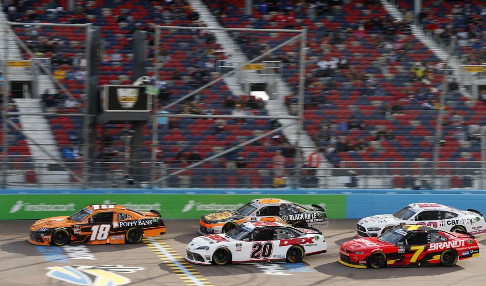 Daniel Hemric (18) leads Harrison Burton (20), Noah Gragson (9), Justin Allgaier (7) and Austin Cindric (22) on a restart during a NASCAR Xfinity Series auto race at Phoenix Raceway, Saturday, March 13, 2021, in Avondale, Ariz. (AP Photo/Ralph Freso)