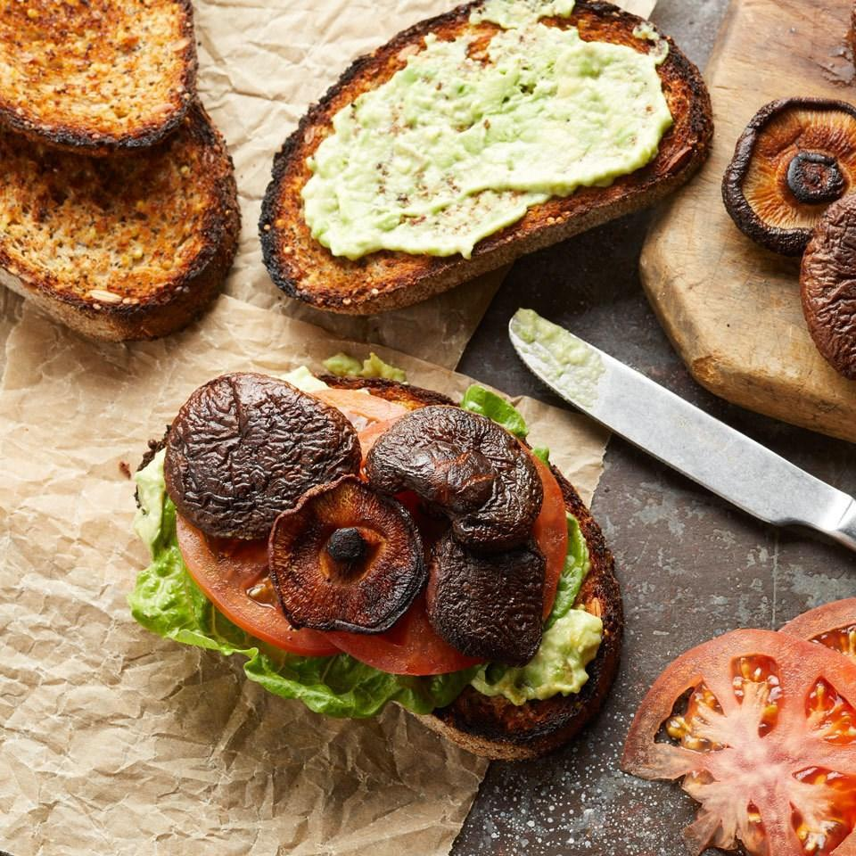 """<p>Roasted shiitake mushrooms doused in soy sauce with a dash of smoked paprika become a natural, vegan alternative to bacon. Try them in this vegan version of a classic BLT with creamy avocado and eggless mayonnaise or on top of a salad as a substitute for bacon bits. <a href=""""https://www.eatingwell.com/recipe/262154/vegan-blats-blts-with-avocado/"""" rel=""""nofollow noopener"""" target=""""_blank"""" data-ylk=""""slk:View Recipe"""" class=""""link rapid-noclick-resp"""">View Recipe</a></p>"""