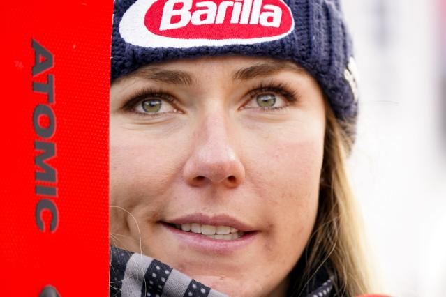 United States' Mikaela Shiffrin stands in the fish Rea after winning an alpine ski, women's World Cup super-G, in Bansko, Bulgaria, Sunday, Jan. 26, 2020. (AP Photo/Giovanni Auletta)