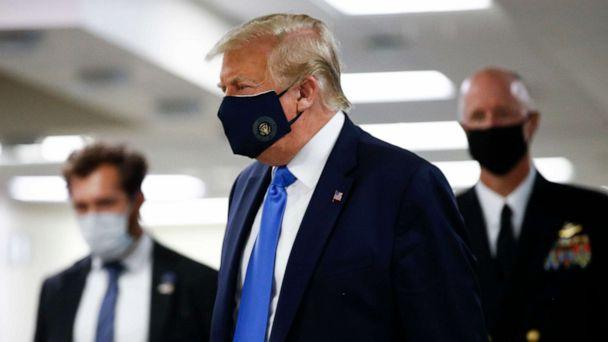 PHOTO: President Donald Trump wears a mask as he walks down the hallway during his visit to Walter Reed National Military Medical Center in Bethesda, Md., Saturday, July 11, 2020. (Patrick Semansky/AP)