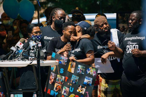 PHOTO: Thomas Gaston and Yasmin Miller, whose son Sincere Gaston was killed in a shooting on June 27, embrace at a vigil while speaking in Chicago, July 1, 2020. (Taylor Glascock/The New York Times via Redux)