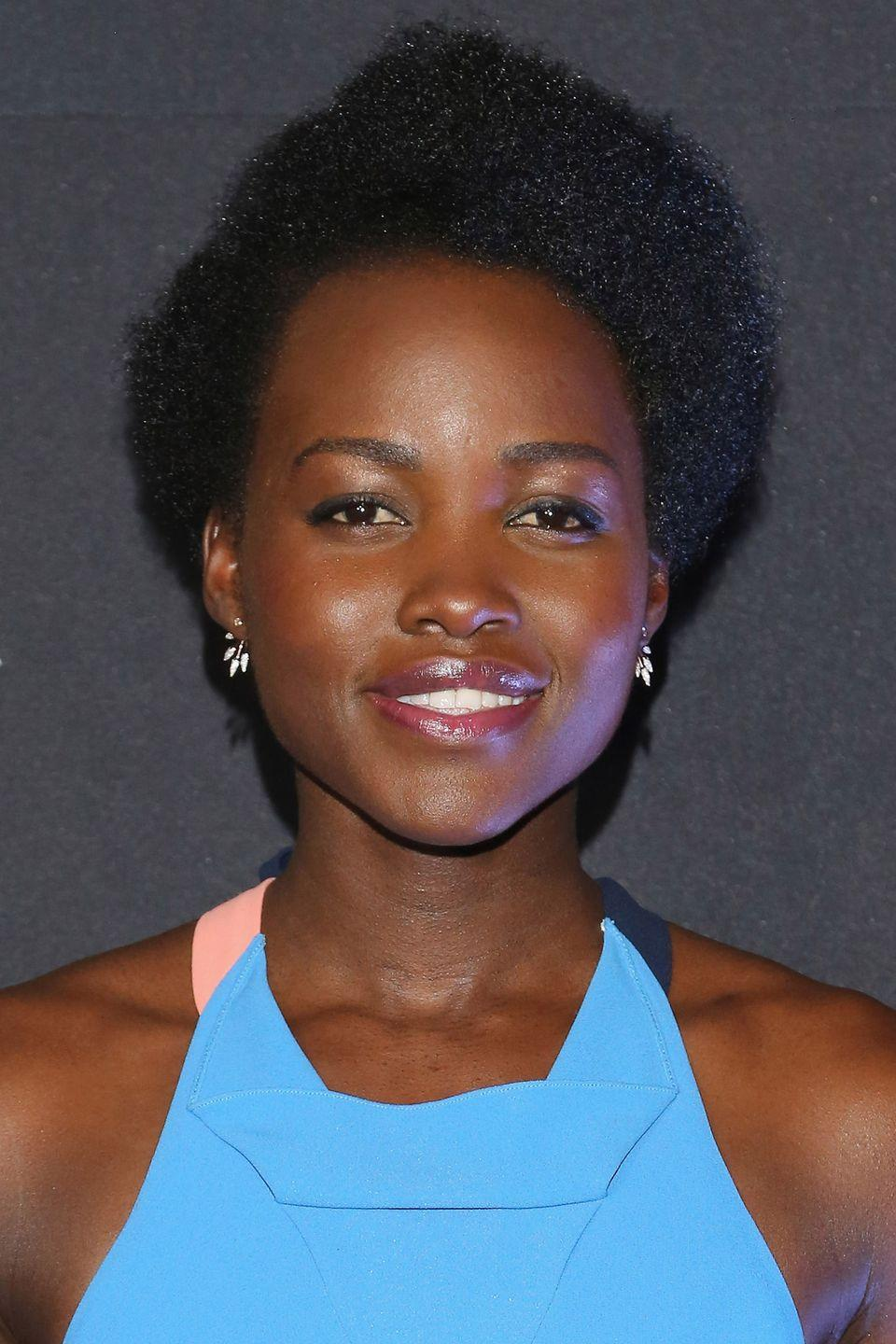 <p>Actress Lupita Nyong'o opts to go au-natural with a simple side part. </p>