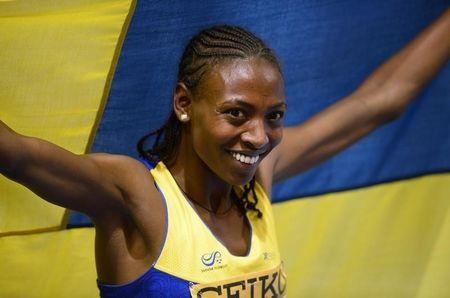 Sweden's Aregawi celebrates after winning gold in the women's 1500m final at world indoor athletics championships in Sopot