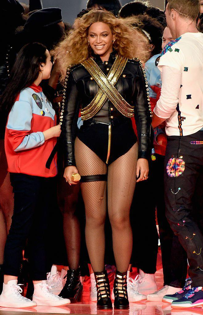 """<p>While Coldplay headlined the Pepsi Superbowl 50 halftime show, Beyoncé and Bruno Mars helped close the show with a tribute to past halftime performances. Beyoncé's military-inspired look was fitting for her performance of """"Formation,"""" leading a crew of backup dancers onto the field. Her support crew was outfitted in black leather jackets and berets reminiscent of Malcolm X and the uniforms worn by The Black Panthers, which was Beyoncé's way of standing in solidarity with the ongoing Black Lives Matter movement. The star's jacket also referenced Michael Jackson's Superbowl XXVII halftime show, when he wore a similar style that was also dripping with gold chains.</p>"""