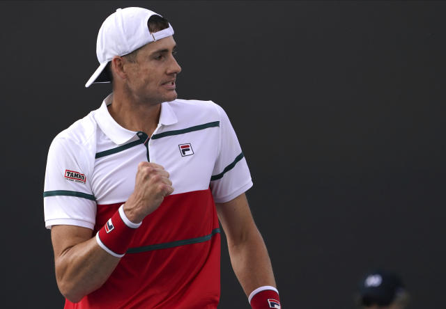 John Isner of the U.S. celebrates after defeating Chile's Alejandro Tabilo in their second round singles match at the Australian Open tennis championship in Melbourne, Australia, Thursday, Jan. 23, 2020. (AP Photo/Lee Jin-man)