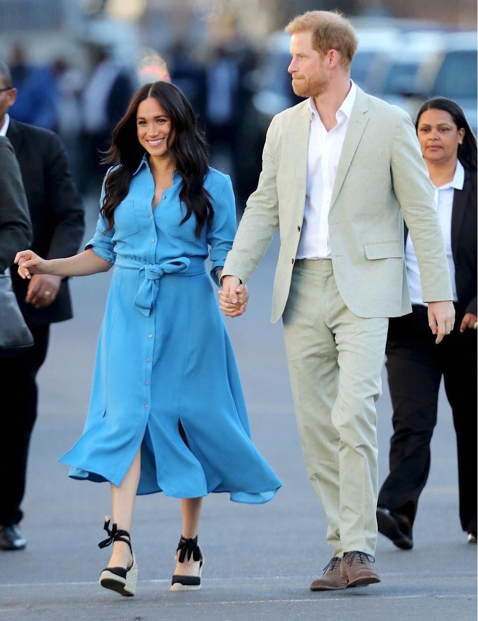 "<p>The Duchess of Sussex repeatedly pulled out her beloved Castañer espadrilles <a href=""https://www.townandcountrymag.com/style/fashion-trends/g29234691/meghan-markle-africa-tour-fashion-outfits-photos/"" rel=""nofollow noopener"" target=""_blank"" data-ylk=""slk:during her and the Duke's royal tour of South Africa"" class=""link rapid-noclick-resp"">during her and the Duke's royal tour of South Africa</a>. The shoes were a natural choice for the balmy climate.<br></p>"