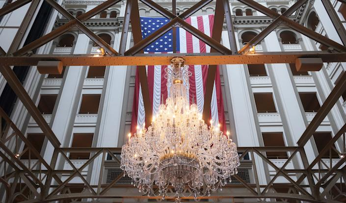 WASHINGTON, DC - FEBRUARY 03:  The American flag hangs in the Trump International Hotel on February 03, 2020 in Washington, DC. Closing arguments began Monday after the Senate voted to block witnesses from appearing in the impeachment trial. The final vote is expected on Wednesday.  (Photo by Mario Tama/Getty Images)