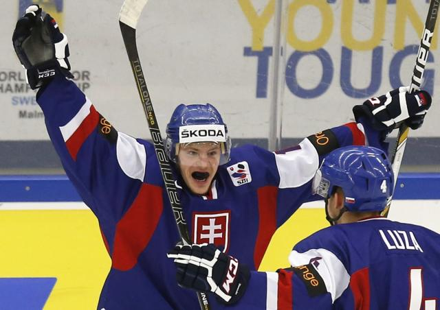 Slovakia's David Griger (L) and Patrik Luza celebrate a goal against Germany during the first period of their IIHF World Junior Championship ice hockey game in Malmo, December 27, 2013. REUTERS/Alexander Demianchuk (SWEDEN - Tags: SPORT ICE HOCKEY)