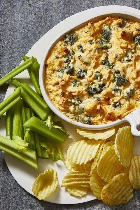 """<p>Because there's nothing better than a warm, gooey cheese dip to kick off football's biggest night of the year.</p><p><em><a href=""""https://www.goodhousekeeping.com/food-recipes/a19738/buffalo-chicken-dip/"""" rel=""""nofollow noopener"""" target=""""_blank"""" data-ylk=""""slk:Get the recipe for Buffalo Chicken Dip »"""" class=""""link rapid-noclick-resp"""">Get the recipe for Buffalo Chicken Dip »</a></em> </p>"""