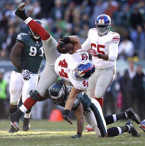 New York Giants running back Peyton Hillis (44) is tackled by Philadelphia Eagles' Mychal Kendricks (95) during the second half of an NFL football game Sunday, Oct. 27, 2013 in Philadelphia. The Giants won the game 15-7. (AP Photo/Matt Rourke)