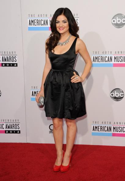Lucy Hale arrives on the 2012 American Music Awards red carpet.