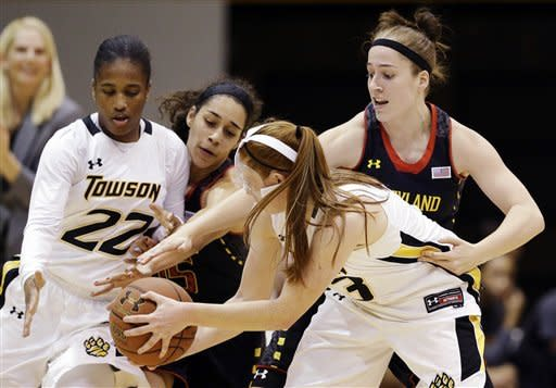 Towson guards Tanisha McTiller (22) and Ciara Webb, second from right, struggle for possession of the ball as they are pressured by Maryland guards Chloe Pavlech, second from left, and Katie Rutan, right, in the first half of an NCAA college basketball game in Towson, Md., Tuesday, Dec. 11, 2012. (AP Photo/Patrick Semansky)