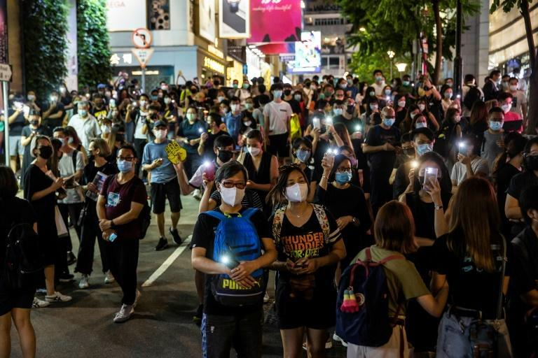Unable to muster in the traditional park, some shone mobile phone torches in nearby streets