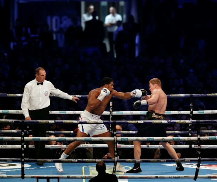 Joshua on the attack against Povetkin but he has still to convince some pundits of his boxing class
