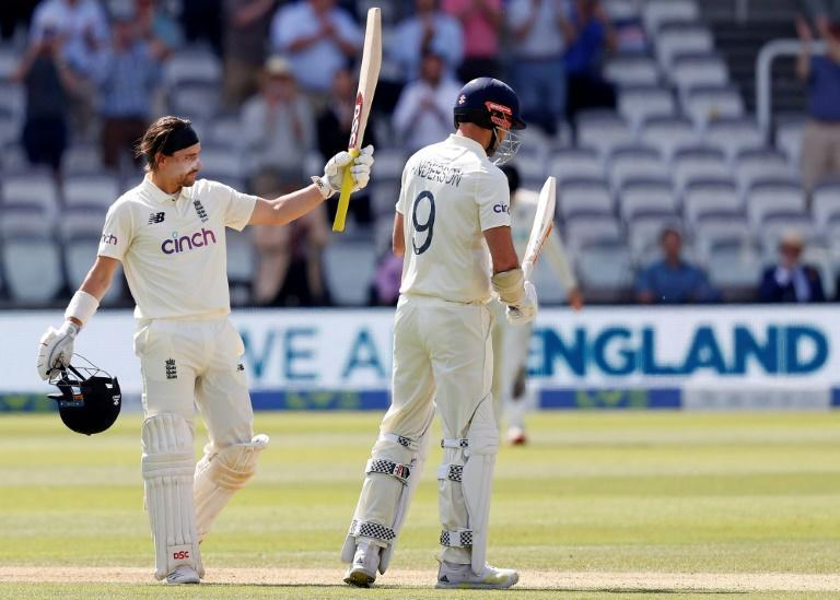 Hundred hero - England's Rory Burns (L) celebrates his century on the fourth day of the first Test against New Zealand at Lord's on Saturday