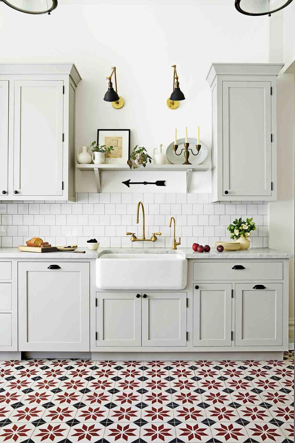 """<p>Rugs, however durable, aren't always practical for a heavy-use kitchen. Enter statement floor tile. A little goes a long way, which means this can be a good place to splurge. Go to <em><a href=""""https://www.granadatile.com/"""" rel=""""nofollow noopener"""" target=""""_blank"""" data-ylk=""""slk:granadatile.com"""" class=""""link rapid-noclick-resp"""">granadatile.com</a></em> for similar quilt-like patterns. </p>"""