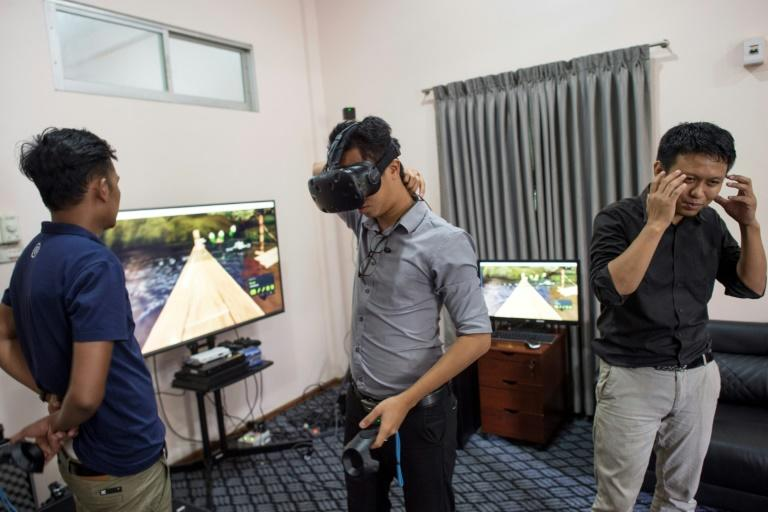 Nyi Lin Seck (R) uses virtual reality technology to preserve a digital replica of Myanmar's archaeological treasures